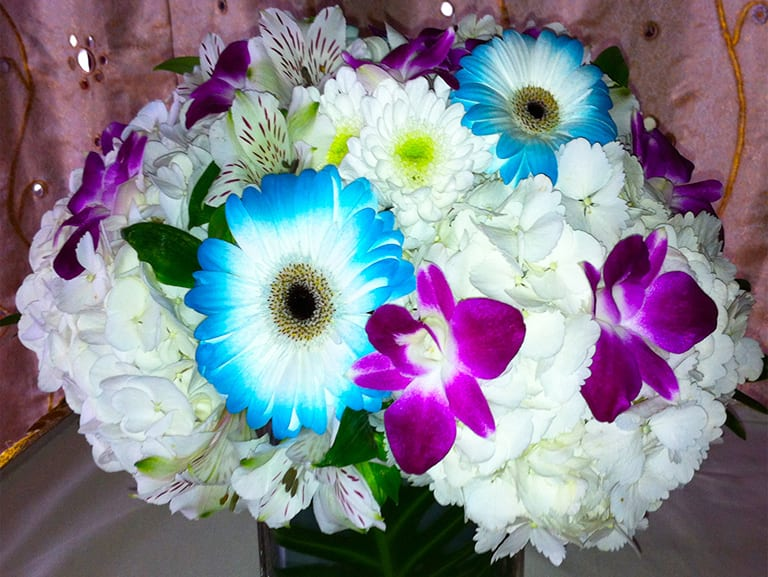 Colourful Floral Centerpiece ~ white hydrangea, gerbera dasies, white chrysanthemums, white alstromaria, purple dendrobium orchids