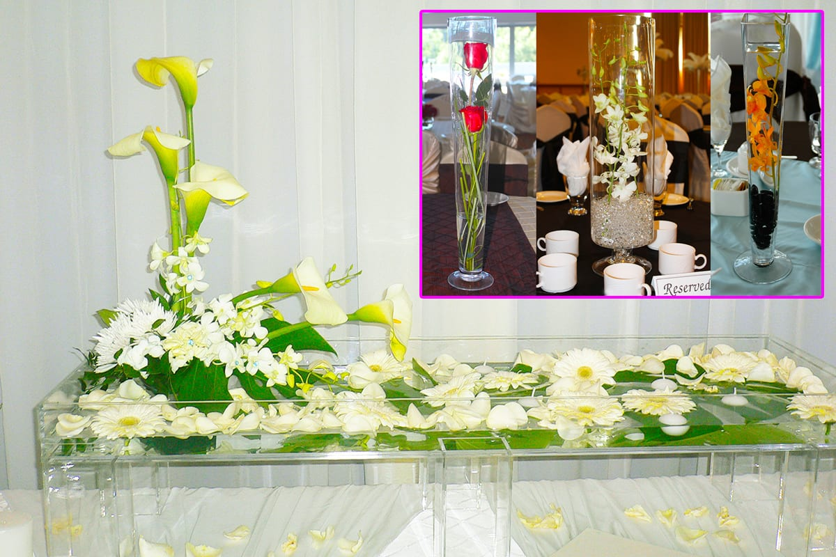 Plexiglass Floral Wedding Entrance Table with gerbera daisies, orchids, calla lilies, hydrangea, chrysanthemums