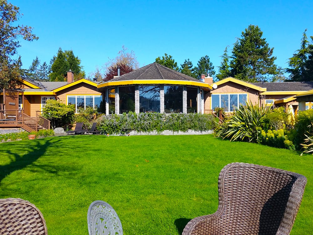 Enjoy a good book or conversation in the gardens of Galiano Oceanfront Inn and Spa