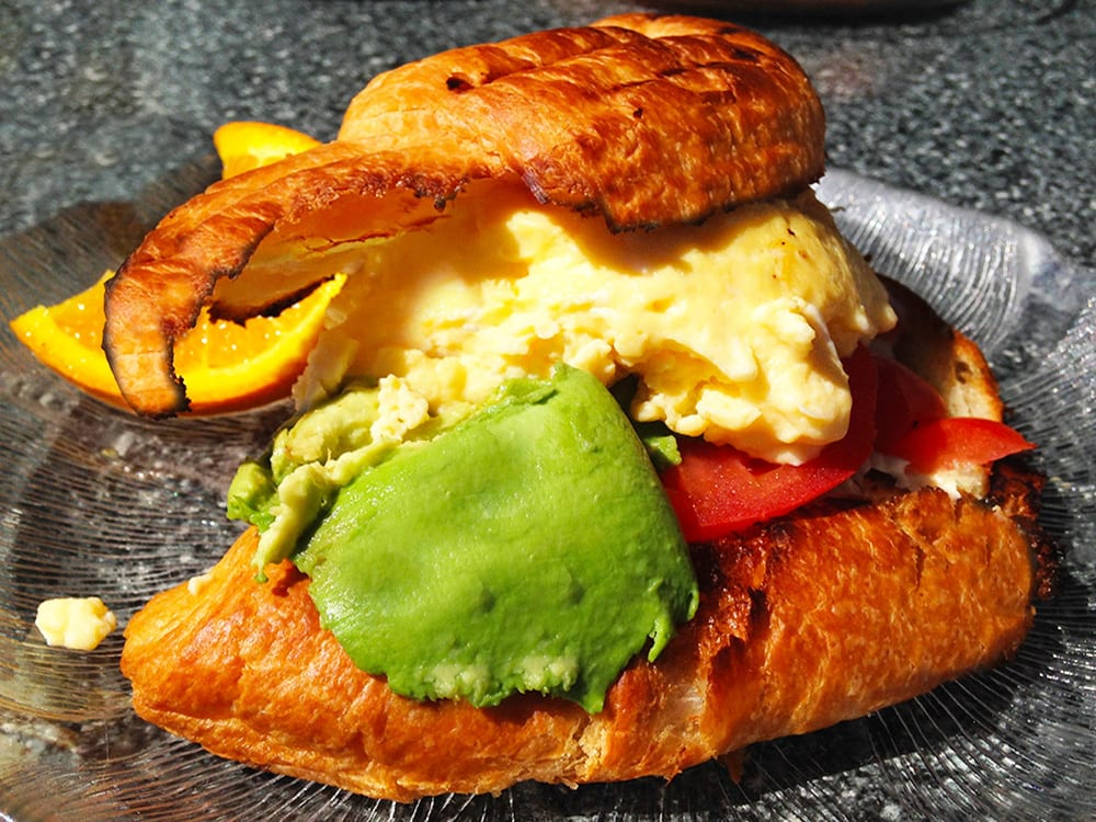 Eye Opener ~ 2 XL steamed eggs on a fresh butter croissant with tomato & avocado at the All-Day Cafe
