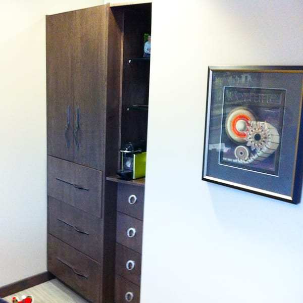 Space Saver Floor to Ceiling storage in Commercial Office by Brothers Cabinets and Design